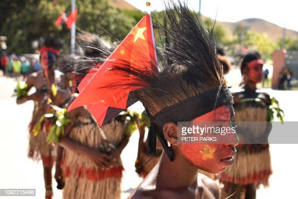 Performers arrive ahead of China's President Xi Jinping before his visit to the Butuka Academy school in Port Moresby on November 16 ahead of the...