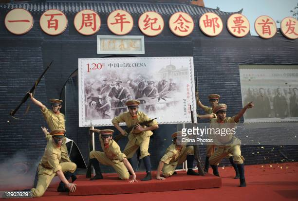 Performers attend a ceremony to release new stamps to mark the 100th anniversary of Wuchang Uprising at the 1911 Revolution Museum on October 10 2011...
