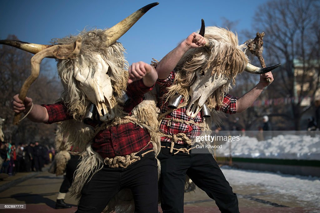 Performers bang their bells together as they make their way to the town square for the first day of the annual Surva International Festival of the Masquerade Games on January 28, 2017 in Pernik, Bulgaria. The two day Surva festival is the largest traditional folklore events of this type across the whole Balkan Peninsula. Around 6000 people from every folklore region of Bulgaria, participate in the pagan event which sees masked Kukers, (mummers) and Survakari dancers, as well as costumed pagan dancers from across the wider region parade through the city streets. The Kukeri tradition is included in UNESCO's list of protected non-material cultural heritage.