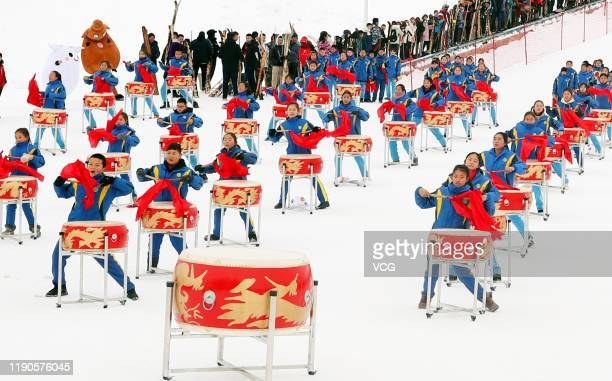 Performers beat drums to celebrate the 14th Xinjiang Winter Tourism Trade Fair at a ski resort on Jiangjun Mountain on November 27 2019 in Altay...