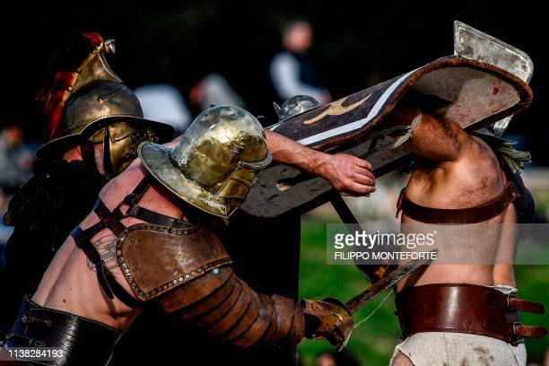 TOPSHOT Performers belonging to a historical group dressed as ancient Roman centurions reenact a fight during the 'Natale di Roma' event on the eve...