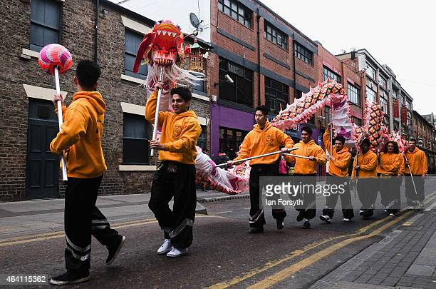 Performers carry the Dragon through the street ahead of the traditional dance as the Chinese community come together to welcome in the Chinese New...