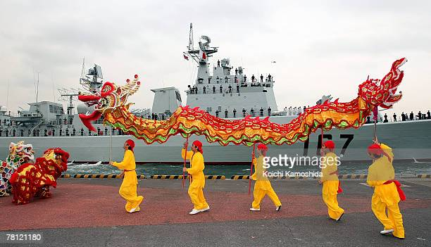 Performers celebrate the Chinese naval missile destroyer Shenzhen as it arrives at Harumi pier November 28 2007 in Tokyo Japan The Japanese Maritime...