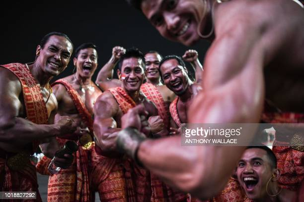 TOPSHOT Performers cheer as they wait to take part at the opening ceremony of the 2018 Asian Games in Jakarta on August 18 2018