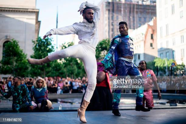 Performers compete during the Battle of the Legends vogueing competition outside the Met on June 11 2019 in New York City In celebration of Pride...