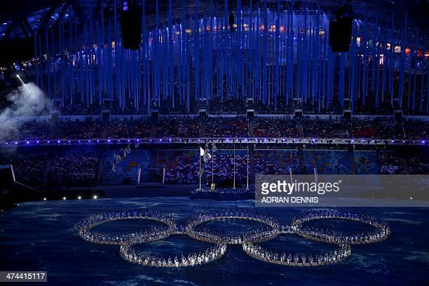 Performers create the shape of the Olympic rings during the Closing Ceremony of the Sochi Winter Olympics at the Fisht Olympic Stadium on February 23...