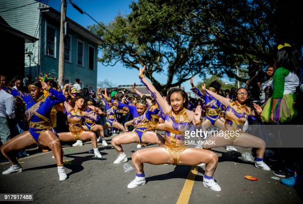 TOPSHOT Performers dance as the Zulu Parade runs through New Orleans on Mardi Gras February 13 2018 / AFP PHOTO / 00059360A / Emily Kask