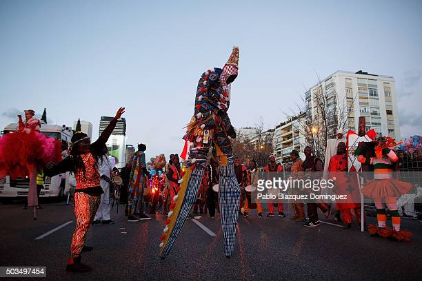 Performers dance as they wait for the start of the 'Cabalgata de Reyes' or the Three Kings parade on January 5 2016 in Madrid Spain The traditional...