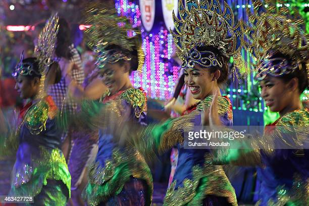 Performers dance down the street during the Chingay SG50 National Education Show at the F1 Pit Building on February 14 2015 in Singapore 10000...