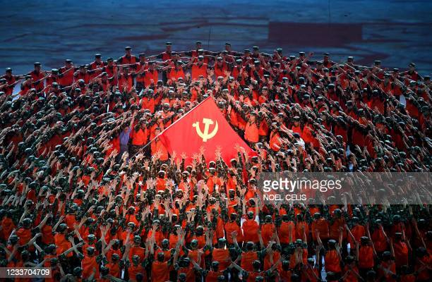 Performers dance during a Cultural Performance as part of the celebration of the 100th Anniversary of the Founding of the Communist Party of China,...