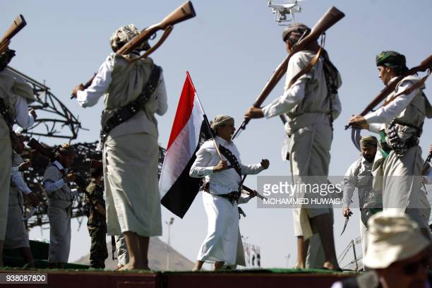 TOPSHOT Performers dance during a rally to mark three years of war on the country in the capital Sanaa on March 26 2018 A Saudiled military coalition...