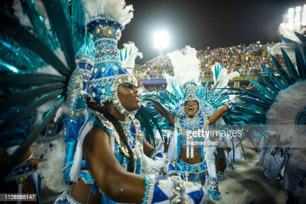 Performers dance during Beija Flor performance at the Rio de Janeiro Carnival at Sambodromo on March 3, 2019 in Rio de Janeiro, Brazil.