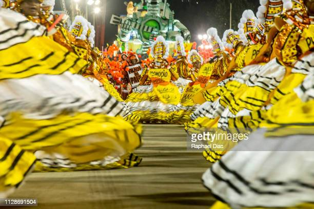 Performers dance during Sao Clemente performance at the Rio de Janeiro Carnival at Sambodromo on March 4 2019 in Rio de Janeiro Brazil