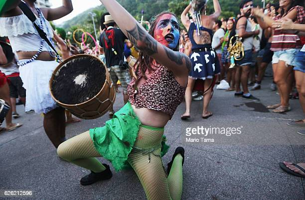 Performers dance during the 2016 Honk Rio Festival a celebration of brass bands on November 27 2016 in Rio de Janeiro Brazil The fourday festival...