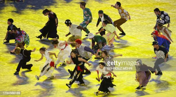 Performers dance during the closing ceremony of the Tokyo 2020 Olympic Games, on August 8, 2021 at the Olympic Stadium in Tokyo.