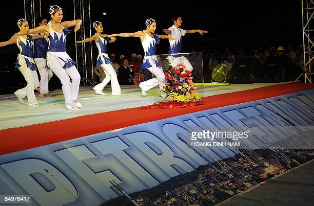 Performers dance during the inauguration ceremony of Dung Quat oil refinery Vietnam's first on February 22 2009 in the central province of Quang Ngai...