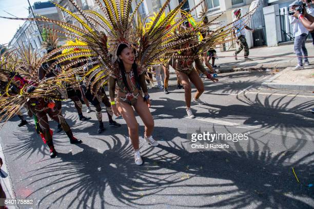 Performers dance during the Notting Hill Carnival parade on August 28, 2017 in London, England. The Notting Hill Carnival has taken place since 1966...