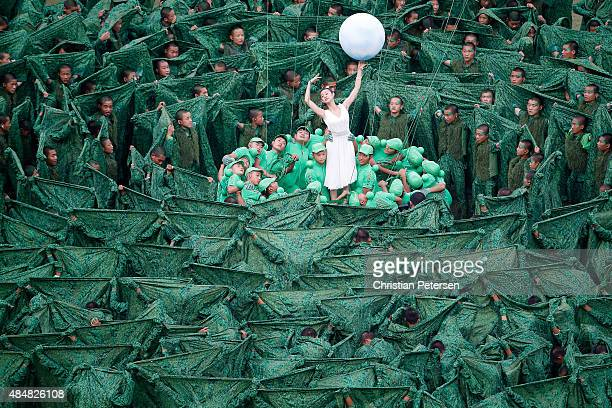 Performers dance during the Opening Ceremony for the 15th IAAF World Athletics Championships Beijing 2015 at Beijing National Stadium on August 22...