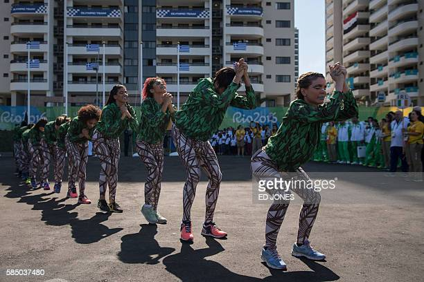 Performers dance for the Olympic teams of Ireland Rwanda Turkmenistan and Afghanistan during a welcoming ceremony at the Athletes' Village of the Rio...
