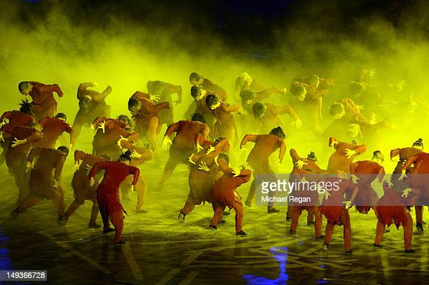Performers dance in a scene depicting the struggle between life and death during the Opening Ceremony of the London 2012 Olympic Games at the Olympic...