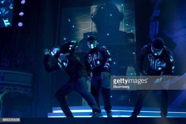 Performers dance on stage during the announcement of the Just Dance 2018 video game during the Ubisoft Entertainment SA event ahead of the E3...