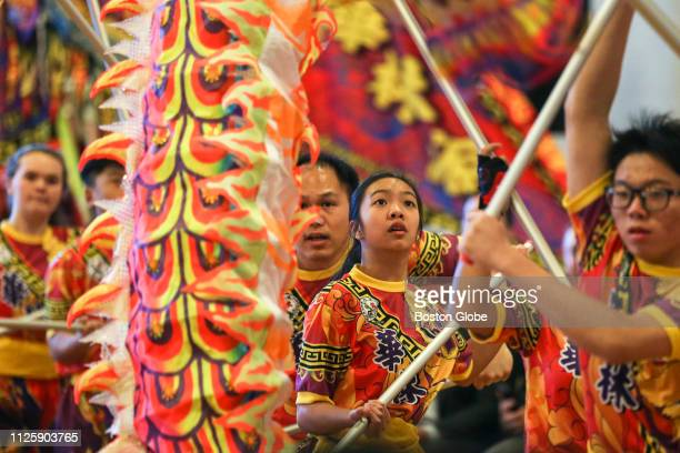 Performers dance with a dragon during the 31st annual Lunar New Year Festival at North Quincy High School in Quincy MA on Feb 10 2019