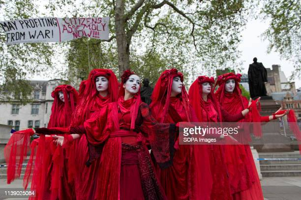 Performers demonstrate at Parliament Square during the Extinction Rebellion march Extinction Rebellion protesters march from Marble Arch to...