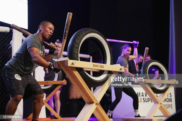Performers demonstrate 'Scape Goat' a functional training session during the Martial Arts SuperShow Europe on August 12 2018 in Dortmund Germany
