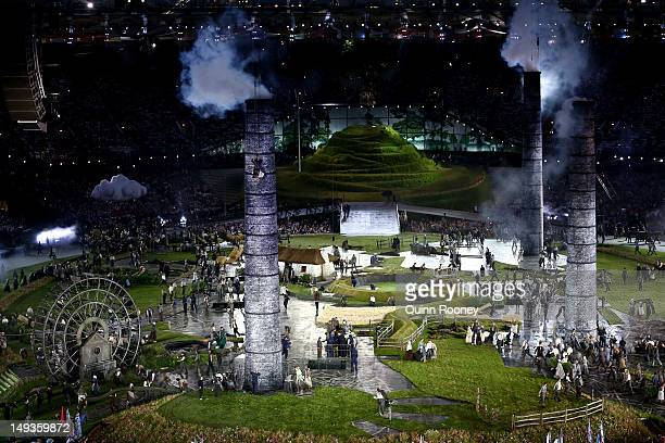 Performers depict a view from the change of the English countryside to the Industrial Revolution during the Opening Ceremony of the London 2012...