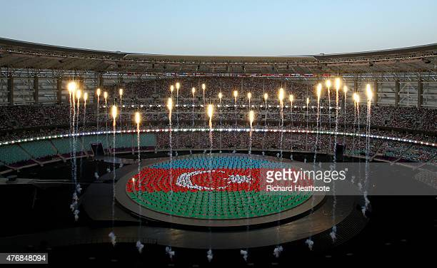 Performers depict the national flag of Azerbaijan during the Opening Ceremony for the Baku 2015 European Games at the Olympic Stadium on June 12,...