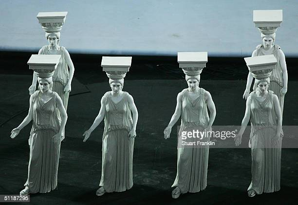 Performers dressed as ancient greek statues act out a scene representing a period of Greek culture and art during the opening ceremony of the Athens...