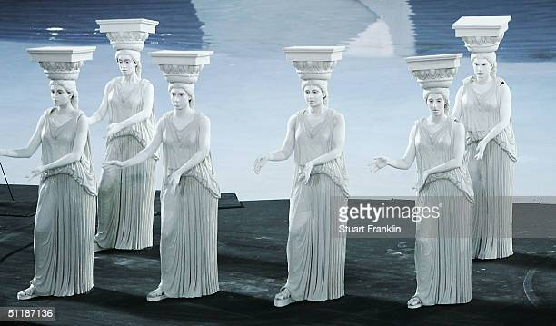Performers dressed as ancient greek statues acts out a scene representing a period of Greek culture and art during the opening ceremony of the Athens...
