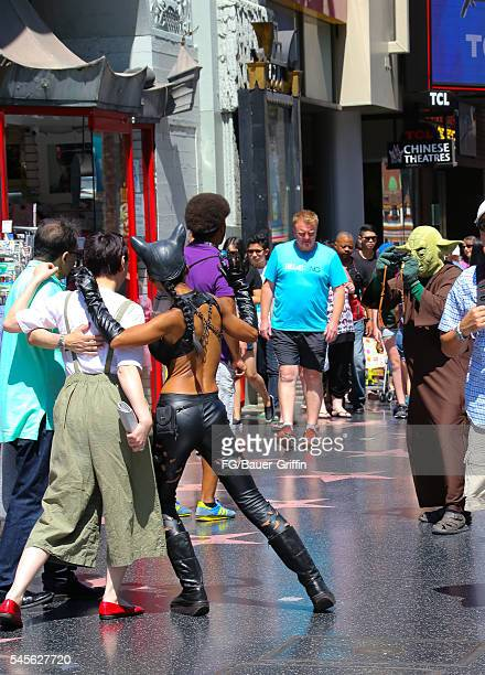 Performers dressed as Catwoman and Yoda seen on Hollywood Boulevard on July 8 2016 in Los Angeles California A recent City of LA ordinance calls for...