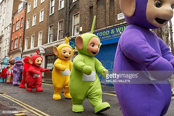 Performers dressed as children's toys and characters from television shows including the Teletubbies prepare to participate in the Hamleys Christmas...