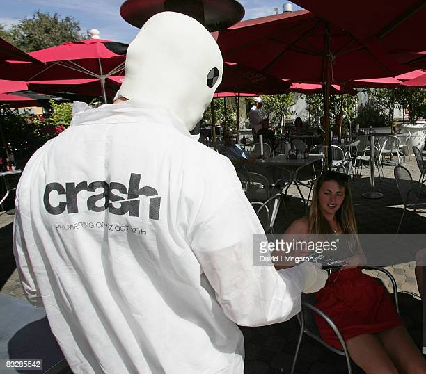 Performers dressed as crash test dummies hand out Crash sweepstakes cards to promote Starz Entertainment's new drama series on Melrose Avenue on...