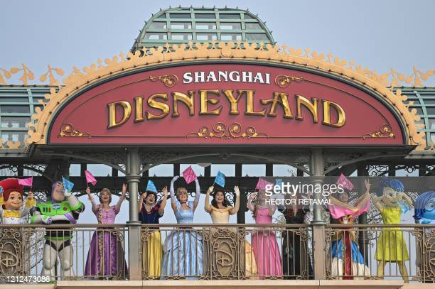 Performers dressed as Disney characters are seen during the reopening of the Disneyland amusement park in Shanghai on May 11 2020 Disneyland Shanghai...