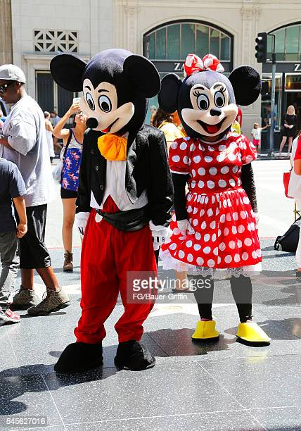 Performers dressed as Mickey Mouse and Minnie Mouse seen on Hollywood Boulevard on July 8 2016 in Los Angeles California A recent City of LA...