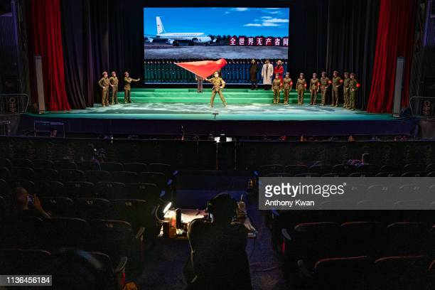 Performers dressed as People's Liberation Army soldiers perform on stage during a rehearsal of a Cantonese opera Trump on Show on April 11 2019 in...