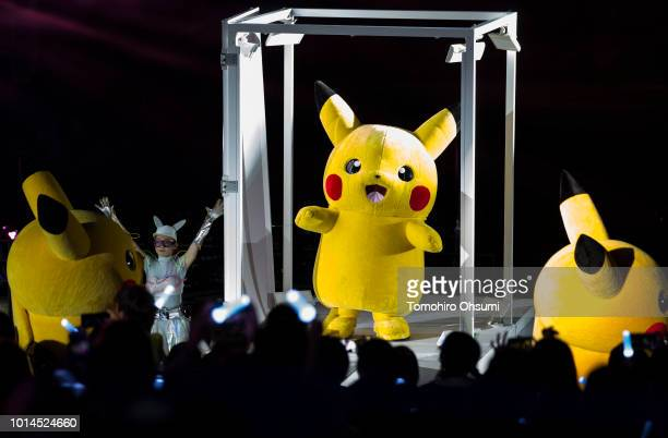 Performers dressed as Pikachu a character from Pokemon series game titles dance during the Pikachu Outbreak event hosted by The Pokemon Co at night...
