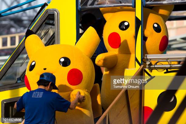 Performers dressed as Pikachu a character from Pokemon series game titles disembark an amphibious bus during the Pikachu Outbreak event hosted by The...