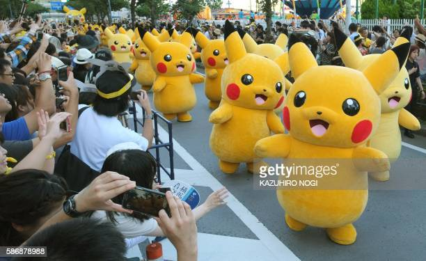Performers dressed as Pikachu the popular animation Pokemon series character perform in the Pikachu parade in Yokohama on August 7 2016 Some 50...