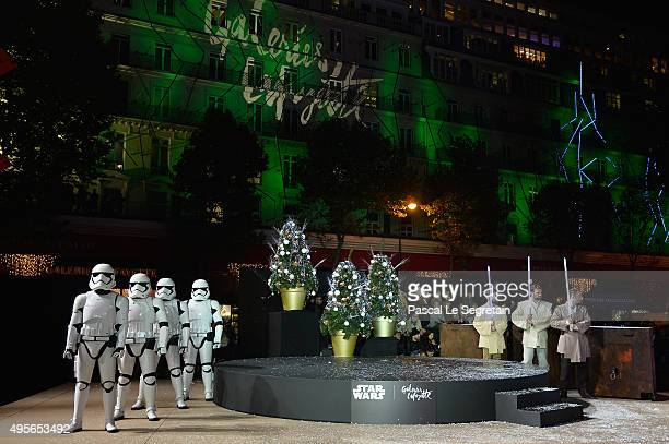 Performers dressed as Star Wars characters pose during the launch of Galeries Lafayette Star Wars Christmas Decorations at Galeries Lafayette on...