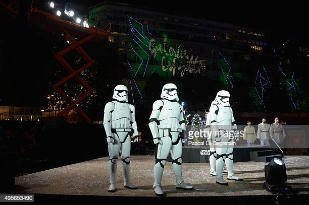 Performers dressed as Stormtroopers pose during the launch of Galeries Lafayette Star Wars Christmas Decorations at Galeries Lafayette on November 4...
