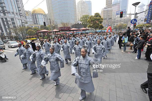 Performers dressed as Terracotta warriors parade in Nanjing Road of Shanghai April 10, 2010. The performance was organised by the Xi'an government to...