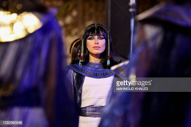 Performers dressed in ancient Egyptian costume wait at the start of the parade of 22 ancient Egyptian royal mummies departing from the Egyptian...