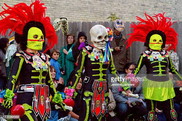 CONTENT] Performers dressed in brightly colored Aztec skeleton costumes at the Dia de los Muertos Parade in Milwaukee WI