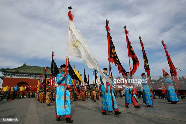 Performers dressed in the costumes of former eunuchs rehearse their steps during an imperial rites ceremony to be staged as a tourist attraction...