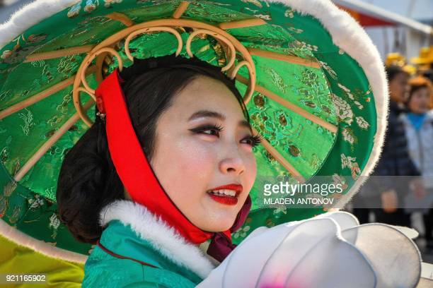Performers dressed in traditional costumes parade in the Gangneung Olympic Park during the Pyeongchang 2018 Winter Olympic Games on February 12, 2018...