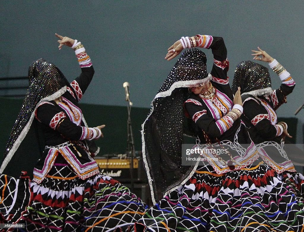Performers during the launch of the Delhi Annshree Yojana on December 15, 2012 in New Delhi, India. Under the scheme monthly cash subsidy of Rs 600 will be transferred directly into bank account of senior-most female member of two lakh poor families.