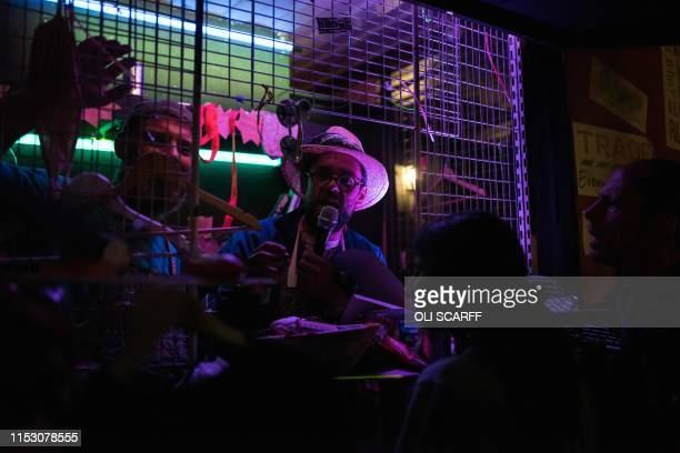 Performers entertain festival-goers in the Shangri-La area of the Glastonbury Festival of Music and Performing Arts on Worthy Farm near the village...